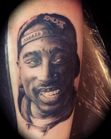 Tupac shakur oklahoma city ink for Thug life tattoo tupac